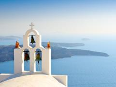 20_Bell-tower-of-church-above-the-beautiful-blue-bay-at-Santorini,Greece
